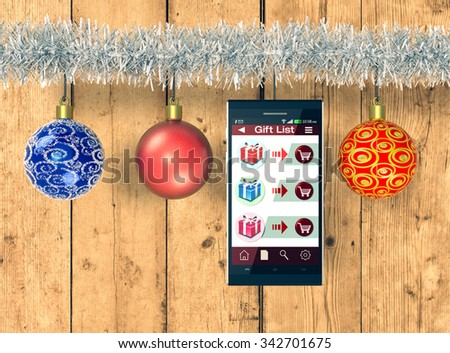 smartphone with an app for online shopping and Christmas decorations, wooden background (3d render) - stock photo