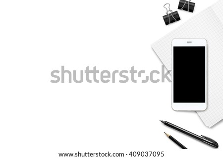 Smartphone with black mockup screen is put on the notebook on modern white office table. Top view with copy space. - stock photo