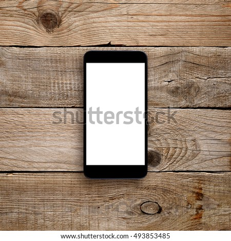 Smartphone with blank screen on wooden background