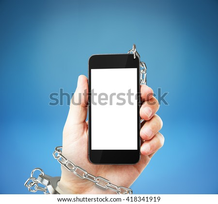 Smartphone with blank white screen cuffed to male hand on blue background. Concept of social problem. Mock up, 3D Rendering - stock photo