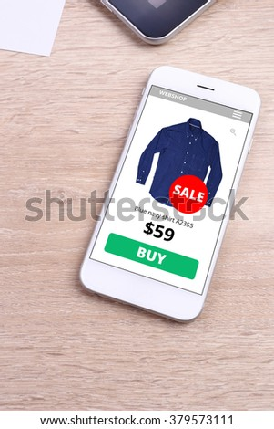 Smartphone with ecommerce website screen - stock photo