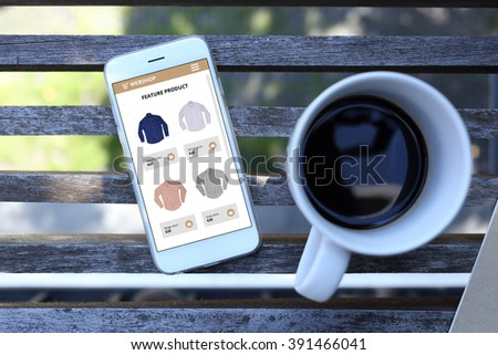 Smartphone with ecommerce website screen and coffee cup - stock photo