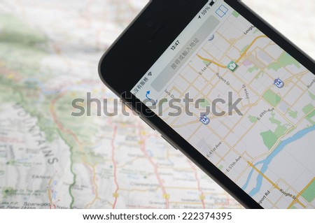 Smartphone with GPS navigator on map  - stock photo