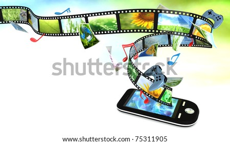 Smartphone with photos, video, music, and games - stock photo