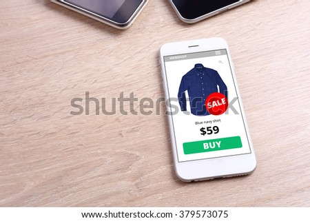Smartphone with shirt ecommerce website screen - stock photo