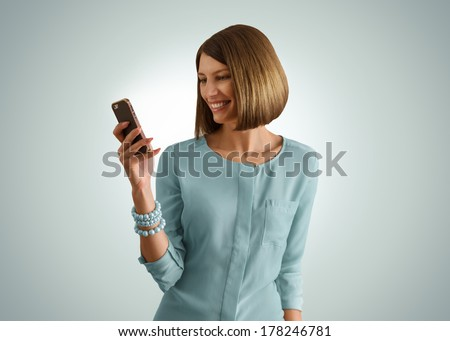 Smartphone woman using app on mobile smart phone smiling happy. Beautiful girl sms text messaging or using application  - stock photo