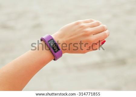 Smartwatch on hand - stock photo