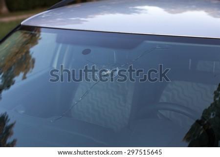 Smashed windscreen of a car, damaged glass - stock photo