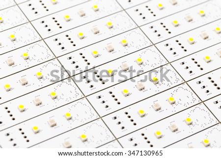 SMD LEDs on White PCB, LED Illumination, LED Assembly, LED Light Production - stock photo