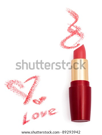 Smeared pink lipstick with hearts isolated on white - stock photo