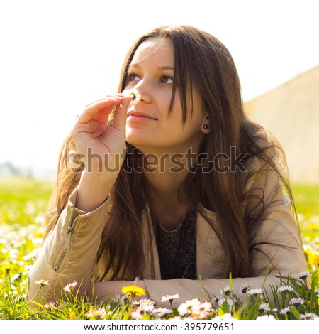 Smelling flowers  - stock photo