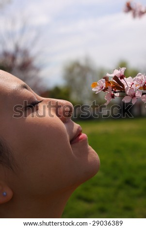 Smelling the flower - stock photo