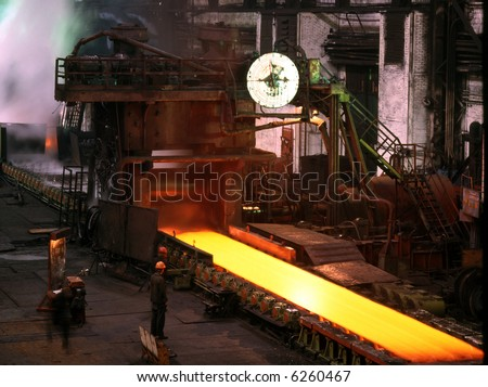 Smelting steels in heavy industry factory. Production of the steel sheet. Heavy plates mill. - stock photo