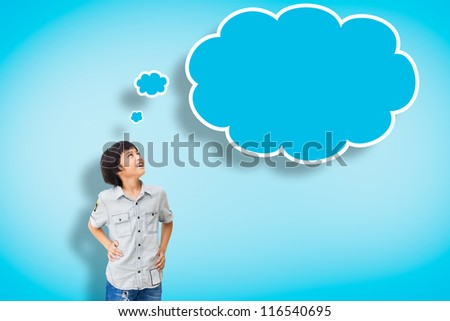 Smile asian boy with empty think bubble on blue background - stock photo