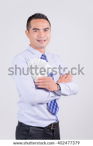 Smile asian business man showing money dollar - stock photo