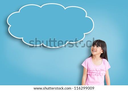 Smile asian little girl with empty think bubble on blue background - stock photo