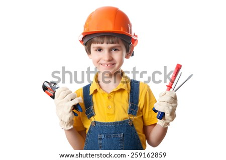 Smile boy holds building tools, isolated on white background - stock photo