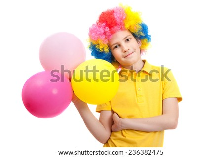 Smile boy in clown wig with balloons at a party, isolated on white background - stock photo