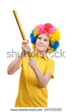 Smile boy in clown wig with party poppers, isolated on white background - stock photo
