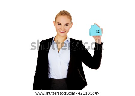 Smile business woman holding a paper house - stock photo