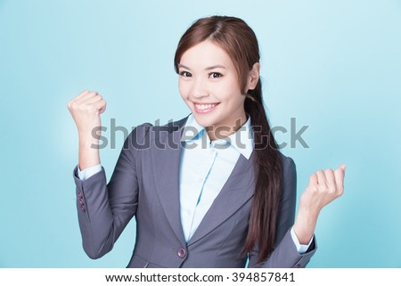 Smile business woman isolated on blue background, asian female - stock photo