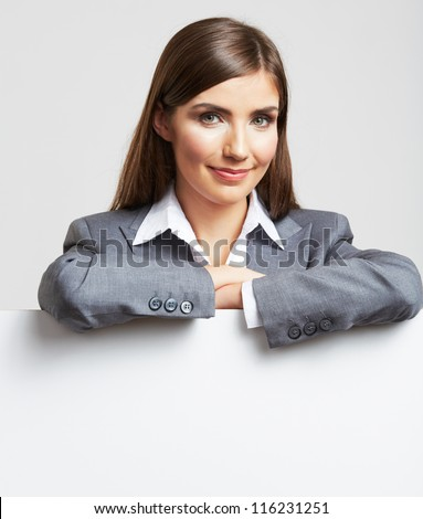Smile Business woman portrait with blank white board on gray isolated . Female model with long hair. - stock photo