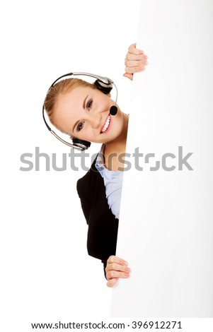 Smile call center woman holding empty banner - stock photo