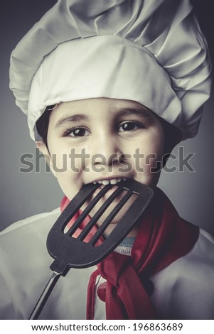 smile, child dress funny chef, cooking utensils - stock photo