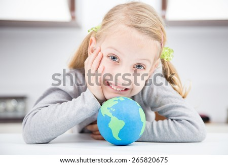 smile girl with clay earth globe - stock photo