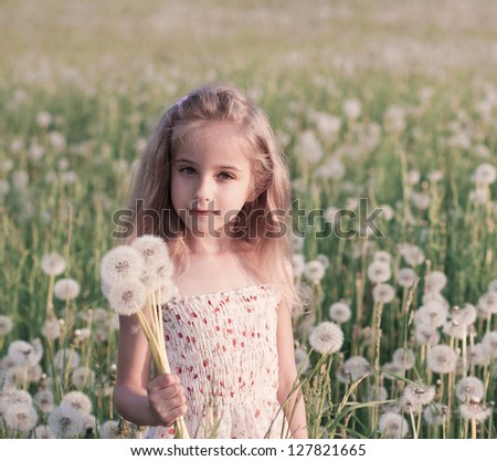smile girl with dandelions - stock photo