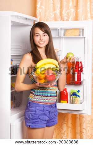 smile girl with fruits in kitchen