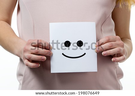 Smile in hands of pregnant woman - isolated photo