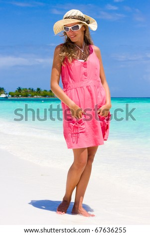 Smile lady on a tropical beach - stock photo