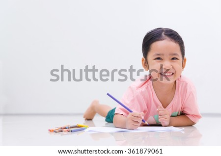 Smile little asian girl with pencil color on white background  - stock photo