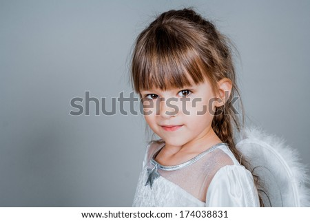 Smile little girl in the camera portrait