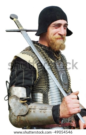 Smile man in an Historical enactment of Knight in armor - stock photo