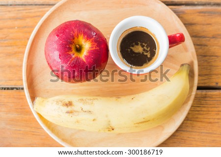 Smile meal with red apple, banana and coffee - stock photo
