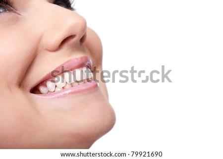 smile of a beautiful young woman , isolated over white background