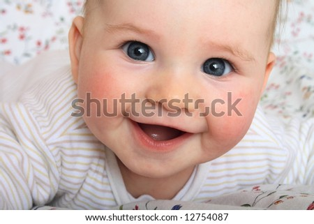 smile of baby [6 months old] - stock photo