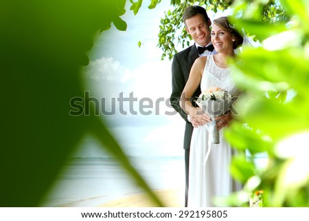 smile of happiness from romantic bride and groom - stock photo