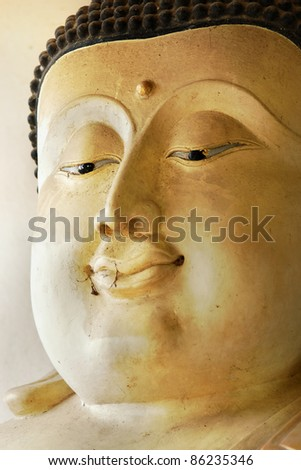 smile of old buddha face