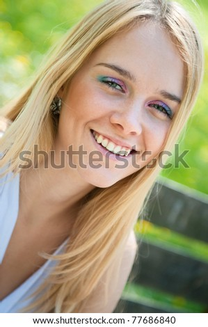 Smile - outside portrait of young woman (teenager) - stock photo