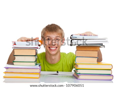 Smile student guy sitting at the desk with pile of books, young man study, isolated over white background