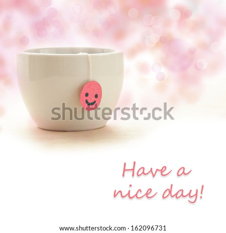 """Smile tea bag in the cup with """"have a nice day"""" text - stock photo"""