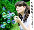 smile teen blowing soap bubbles - stock photo
