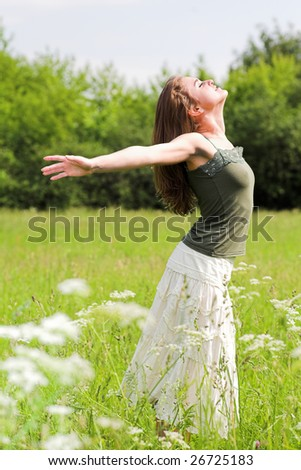 smile teen open hands standing on field - stock photo