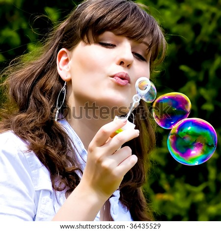 smile teen standing with soap bubbles