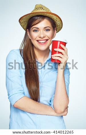 Smile with teeth. Beautiful happy woman posing with coffee cup. Isolated portrait. Yellow hat. - stock photo