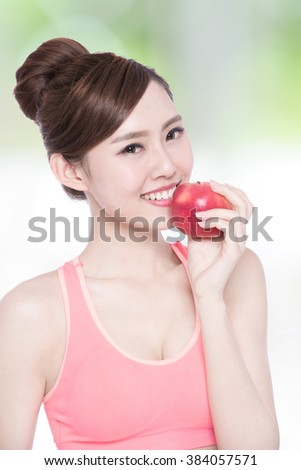 smile woman hold apple with nature green background, asian beauty