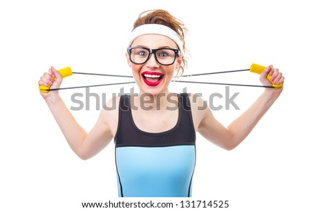 Smile woman playing with expander or stretching, fitness girl over white background. - stock photo